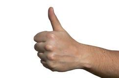 Mano con el pulgar aumentado como gesto de la buena suerte Imágenes de archivo libres de regalías