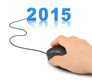 Mano con el ratón y 2015 del ordenador Imagen de archivo
