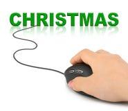 Mano con el ratón y la Navidad del ordenador Foto de archivo