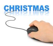 Mano con el ratón y la Navidad del ordenador Imágenes de archivo libres de regalías