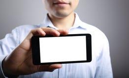 Mano con el teléfono elegante en blanco imágenes de archivo libres de regalías