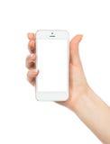 Mano con el teléfono móvil en blanco del móvil del espacio de la copia fotografía de archivo