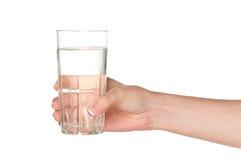 Mano con el vidrio de agua Fotografía de archivo libre de regalías