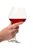 Mano con el vidrio de vino Imagenes de archivo