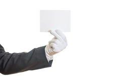 Mano con guantes que sostiene una tarjeta en blanco imagenes de archivo