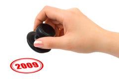Mano con il bollo 2009 Fotografia Stock