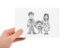 Mano con il disegno della famiglia felice Fotografie Stock Libere da Diritti
