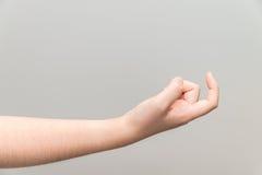 Mano con il dito indice del ricciolo immagini stock
