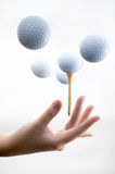 Mano con il golf-ball Fotografia Stock