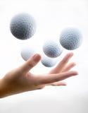 Mano con il golf-ball Fotografie Stock Libere da Diritti