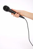 Mano con il microfono Immagini Stock Libere da Diritti