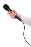 Mano con il microfono Fotografia Stock