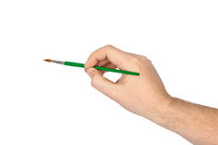 Mano con il pennello Fotografia Stock Libera da Diritti