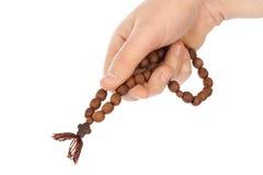 Mano con il rosario Immagine Stock Libera da Diritti