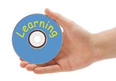 Mano con l'apprendimento del disco Immagini Stock Libere da Diritti