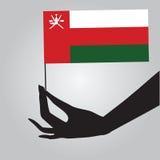 Mano con la bandera Omán Foto de archivo libre de regalías