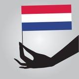 Mano con la bandera Países Bajos ilustración del vector