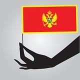 Mano con la bandiera Montenegro Immagine Stock