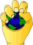 Mano con la bola de la tensión de la tierra. Foto de archivo libre de regalías