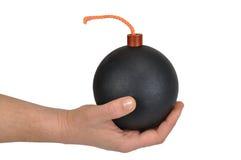 Mano con la bomba Imagen de archivo