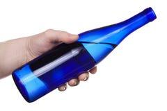 Mano con la bottiglia Fotografia Stock