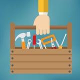 Mano con la caja de herramientas Foto de archivo libre de regalías