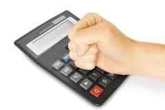 Mano con la calculadora de la oficina Imagen de archivo libre de regalías