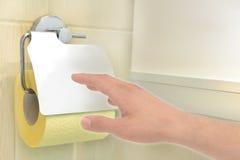 Mano con la carta igienica Fotografie Stock