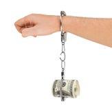 Mano con la fractura de las esposas y del dinero Imagen de archivo