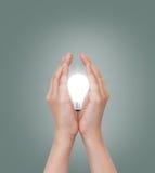 Mano con la lampadina Fotografia Stock