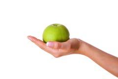 Mano con la manzana foto de archivo