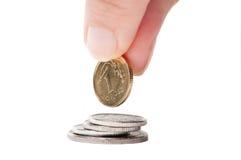 Mano con la moneda polaca Fotografía de archivo