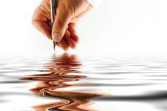 Mano con la penna Fotografia Stock