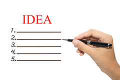 Mano con la penna e la lista di controllo di idea Fotografia Stock Libera da Diritti