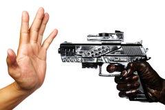 Mano con la pistola macchiata con l'olio per motori che indica la mano vuota Fotografia Stock Libera da Diritti