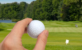 Mano con la sfera di golf Immagini Stock Libere da Diritti