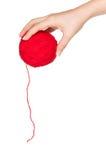 Mano con la sfera rossa Fotografia Stock