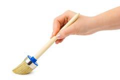 Mano con la spazzola Fotografia Stock Libera da Diritti