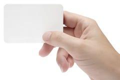 Mano con la tarjeta de visita en blanco imagen de archivo