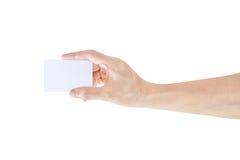 Mano con la tarjeta de visita en blanco Imagenes de archivo