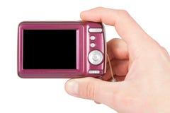 Mano con las cámaras digitales Fotos de archivo