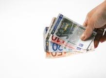 Mano con las cuentas euro Fotos de archivo libres de regalías