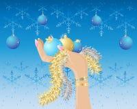 Mano con las decoraciones de la Navidad ilustración del vector