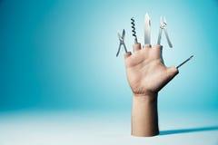 Mano con las herramientas como dedos imagen de archivo libre de regalías