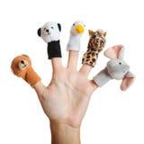 Mano con las marionetas animales Foto de archivo