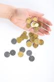 Mano con las monedas Imagen de archivo libre de regalías