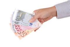 Mano con las notas euro Imagen de archivo libre de regalías