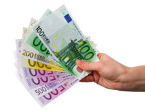 Mano con las notas euro foto de archivo