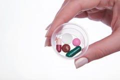 Mano con las píldoras Fotografía de archivo