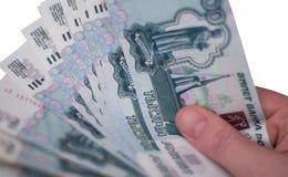 Mano con las rublos Imágenes de archivo libres de regalías
